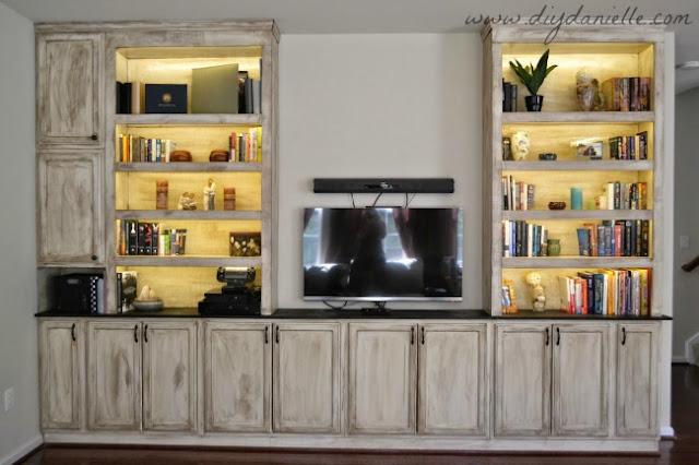 Built-In bookshelves, storage, and entertainment center: lights on.