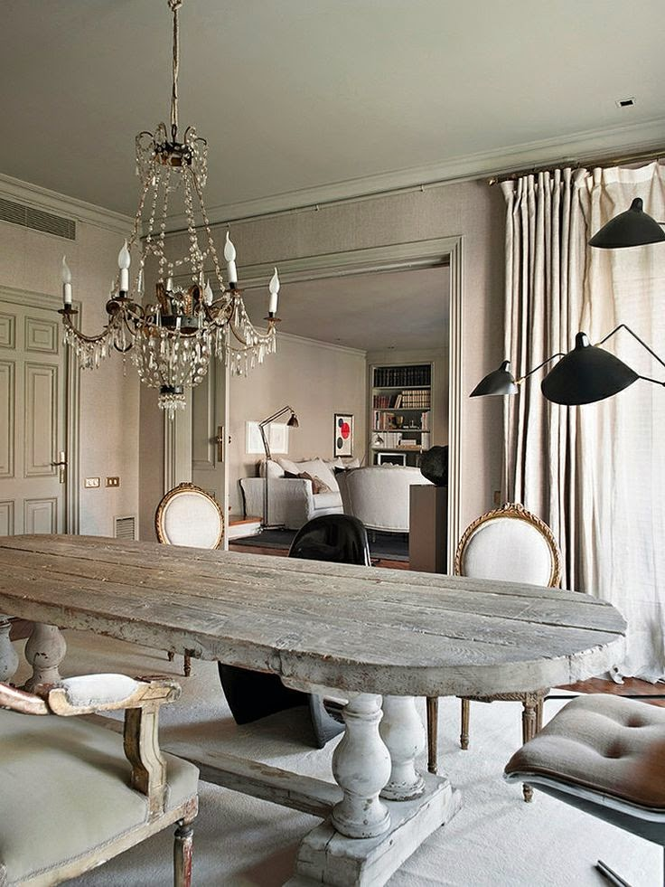 beautiful traditional neutral dining room with floor lamps