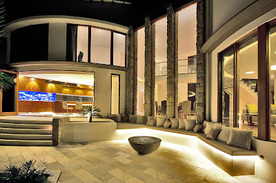 luxurious outdoor with firepit in elegant color palette complete with stunning light effects