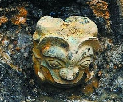 Two-face bronze head unearthed in central China