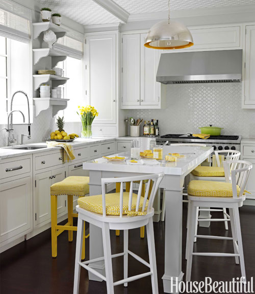 Mix and chic home tour a colorful new york apartment for Kitchen colors with white cabinets with nyc sticker printing