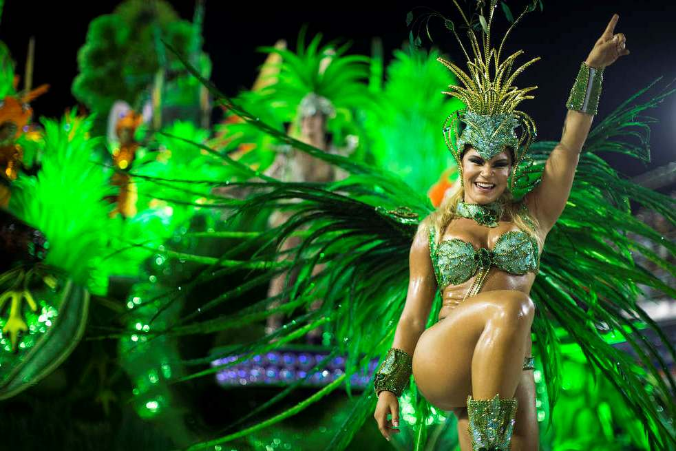 A performer from the Unidos de Vila Isabel samba school parades during Carnival celebrations at the Sambadrome in Rio de Janeiro, Tuesday, Feb. 12, 2013.