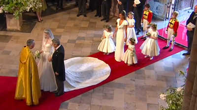 The Middletons inside the Abbey, meet the priest. YouTube 2011.
