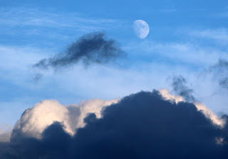 Early moon with big clouds