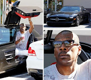 . and actor Eddie Murphy was spotted beside his gleaming black SLS AMG.