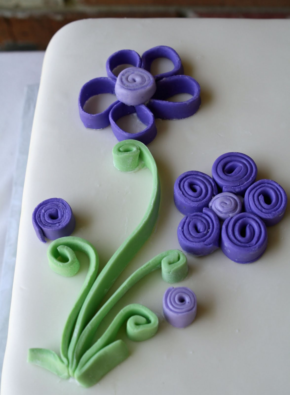 Purple Flowers On A Cake Quilling With Fondant