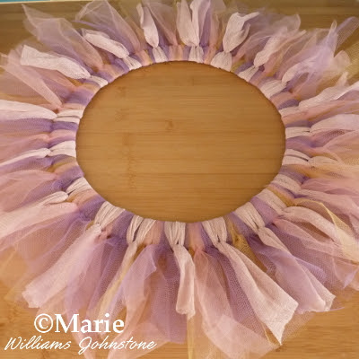 Different colors of tulle netting tied around a wreath