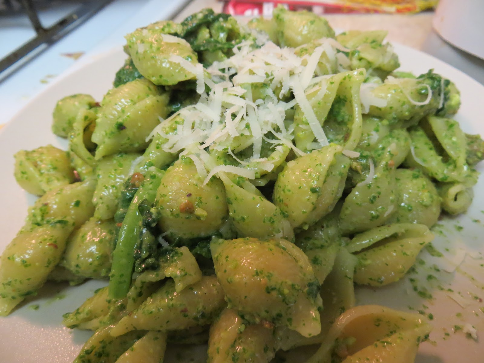 and pesto add some olive oil and parmigiano and stir to combine