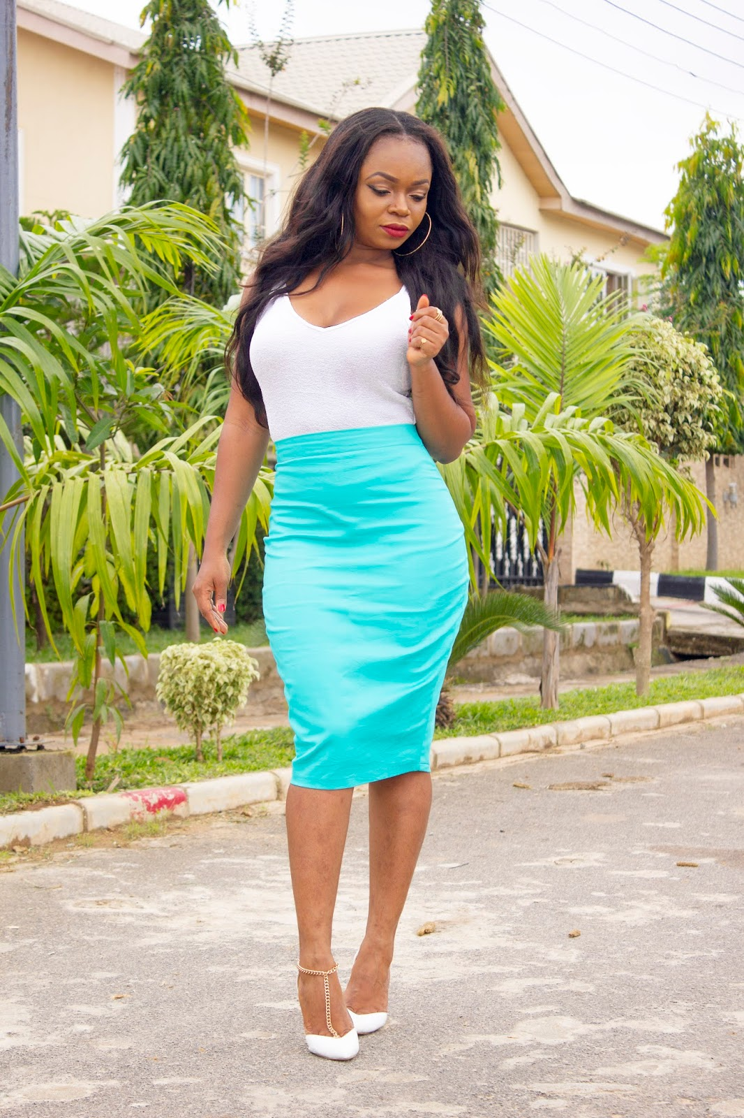 Teal colored pencil skirt with white top