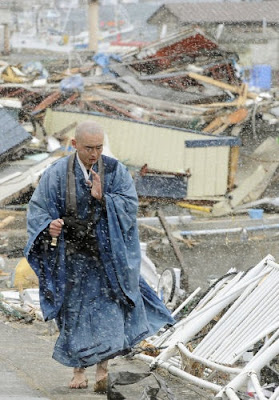 Buddhist monk among the rubble in Yamada, Japan