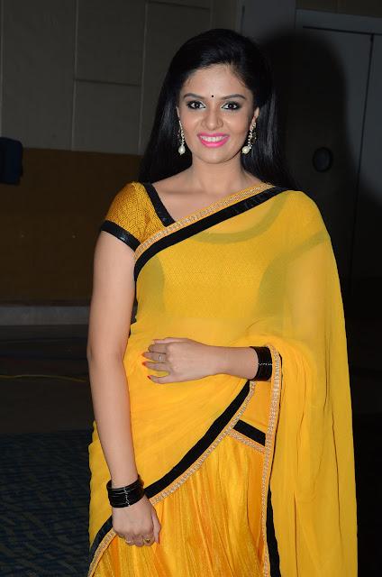 Sri Mukhi Looks Super Cute and Glamorous in Yellow Saree at Hora Hori Audio Launch