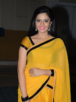 Sri Mukhi glam pics in Yellow saree-cover-photo