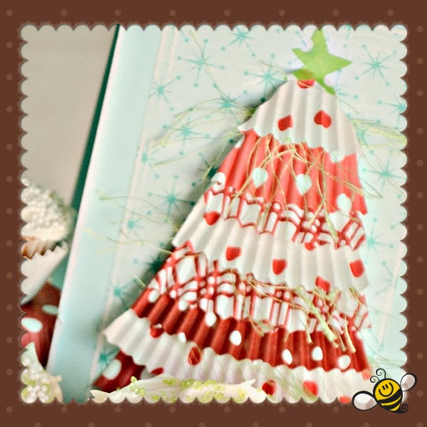 http://tatertotsandjello.com/2011/11/make-cupcake-liner-christmastrees-holiday-tutorial.html