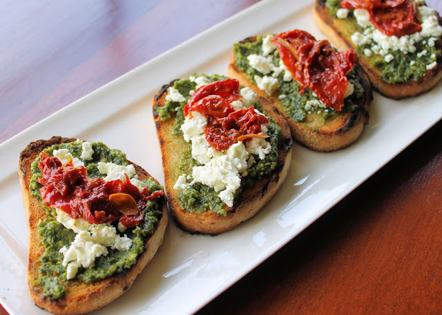 Savoir Faire: Goat Cheese, Basil Pesto and Roasted Tomatoes Crostinis