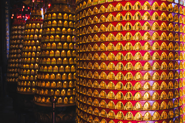 a thousand tiny Buddha statues displayed on spinning columns | Beipu, Taiwan