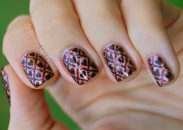 Striping tape and hearts nail art with glitter