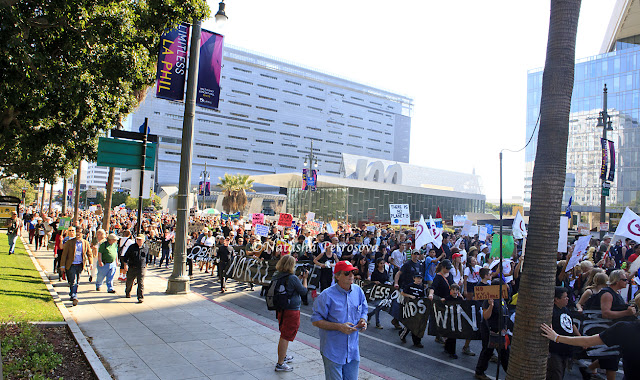protesters march to LA city hall at climate change rally in los angeles, global warming, rally against keystone pipeline in los angeles