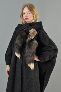 Vintage 1980's charcoal grey wool coat with brown foxtail tie at neckline.