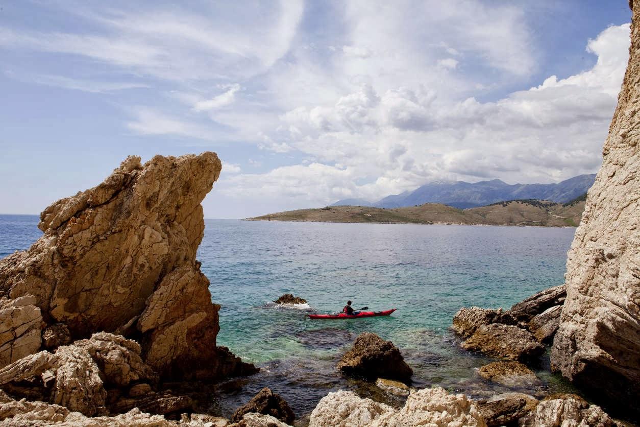 Kayaking near Porto Palermo, Albania. Mustafah Abdulaziz