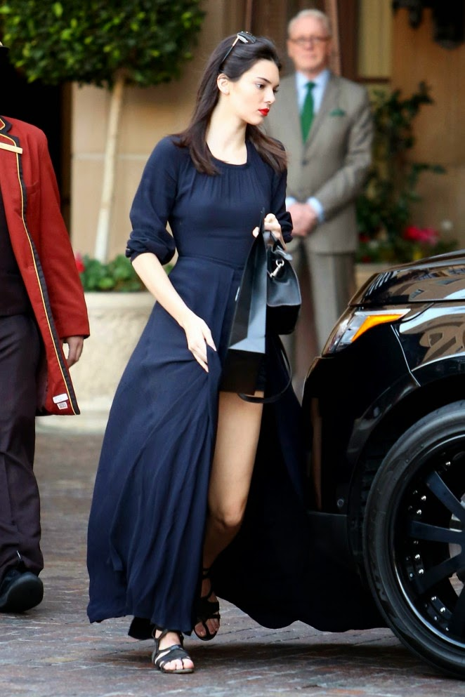 Kendall Jenner shows off legs in black caped playsuit in Beverly Hills