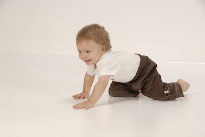 lovely baby boy laughing, playing, crawling picture