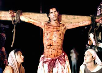 symbolism in the movie jesus of montreal Complete with walking on water, levitation and a painful-looking crucifixion, and set on a hill above montreal's twinkling lights, this is a passion play you'd like to attend: in the film it's too.