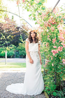 bride wears a floral crown under a floral arch at Elsick House