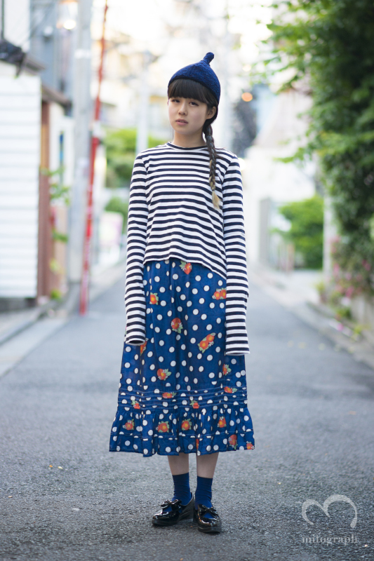 Okame wears Comme des Garcons top Tricot Comme des Garcons skirt UNBILICAL shoes at Harajuku