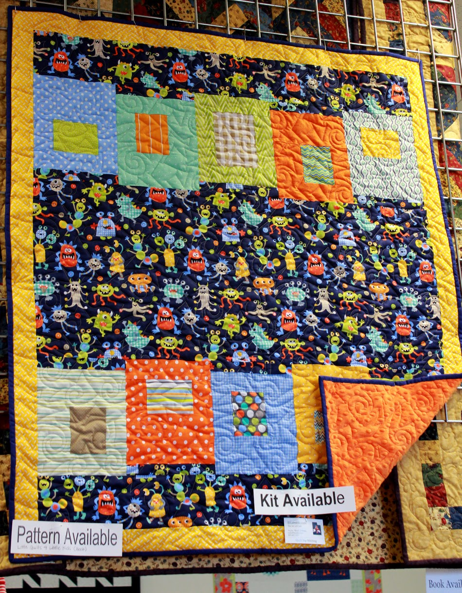 Building Blocks quilt pattern made with cute monsters fabric!