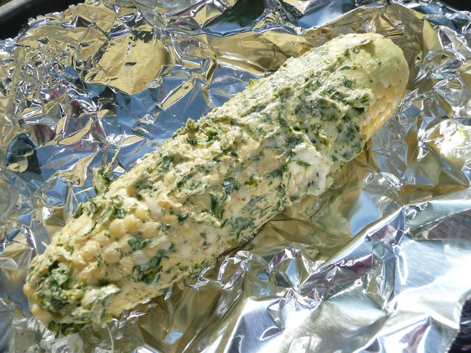 Slather corn with cilantro lime butter before wrapping