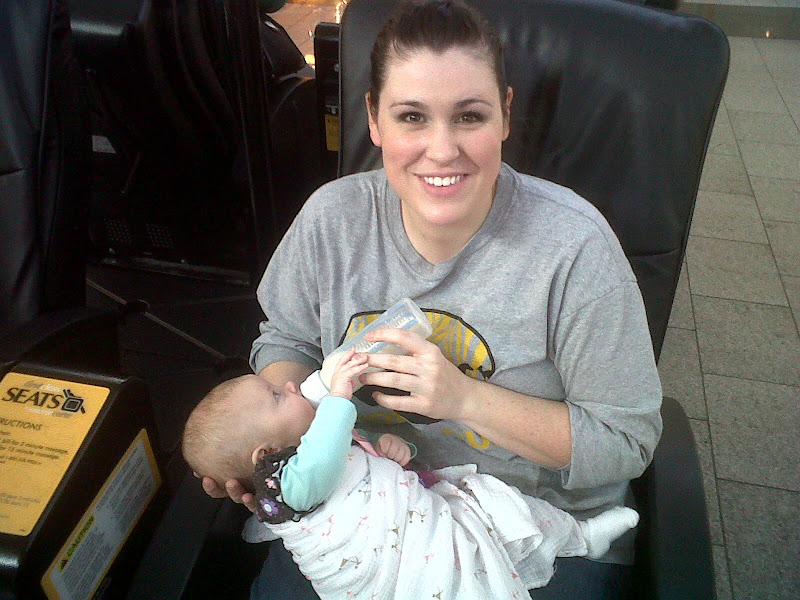 Happy mommy feeding Penny after the piercing! I love her pierced ears  title=