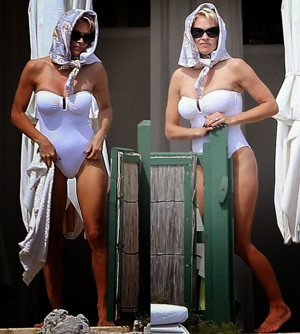 In new fashion design, Pamela Anderson showcases her wonderful looking grown out in a white swimsuit to soaking up the sunshine in Cannes, France on Friday, May 16, 2014.