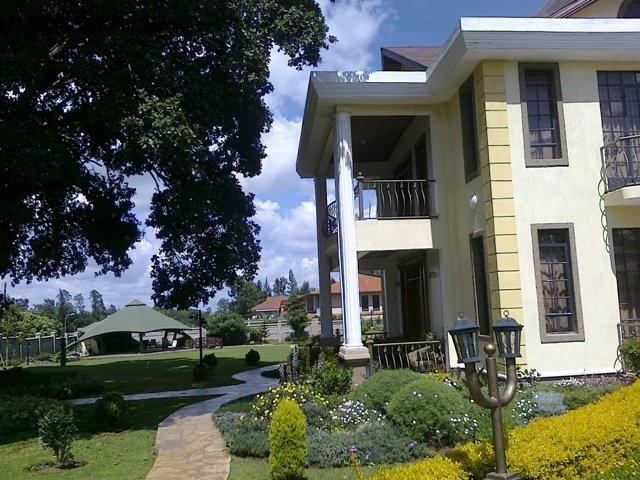 10 photos of the kiunas mansion in runda. Black Bedroom Furniture Sets. Home Design Ideas