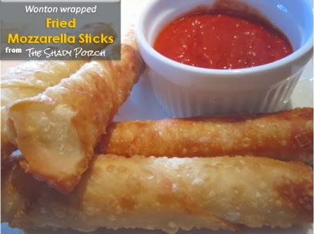 A plate of Mozzarella Sticks and marinara sauce for dipping