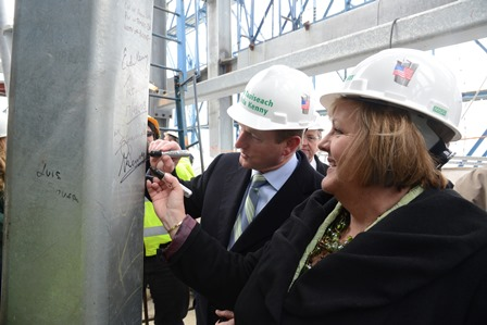 Enda Kenny and his wife sign a girder at the World Trade Center (Photo: James Higgins)