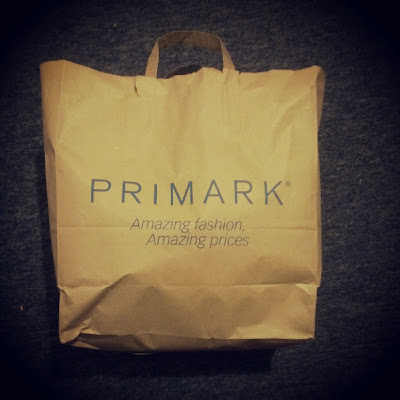 Primark logo brown paper bag