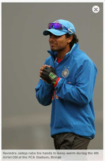 Ravindra+Jadeja+rubs+his+hands+to+keep+warm+during+the+4th+Airtel+ODI+at+the+PCA+Stadium,+Mohali