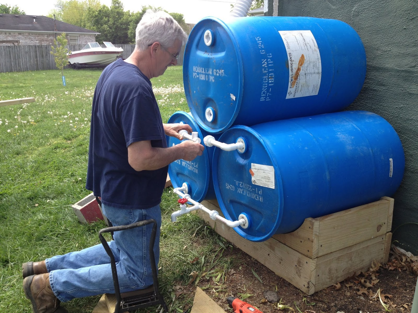 Our adoption adventure the rain barrel system for Making rain barrel system