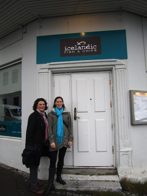 2 women standing in front of Fish and chip shop in Reykjavik, Iceland.