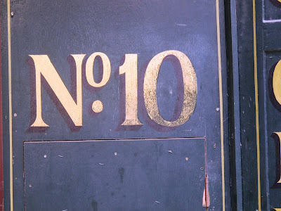 number ten vintage sign in gold