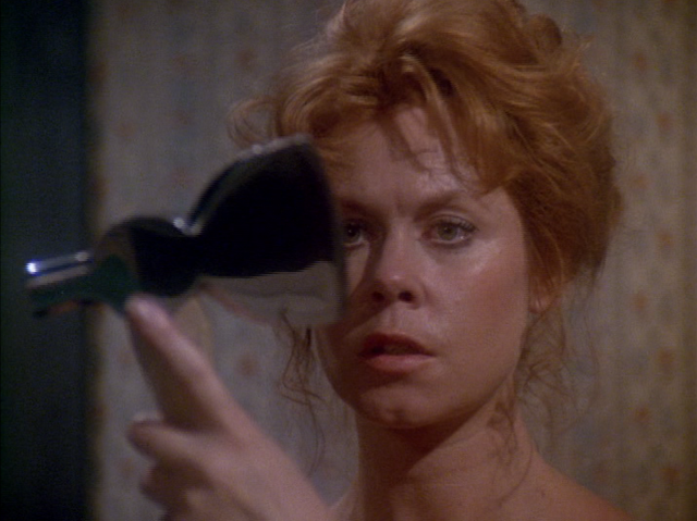 Lizzie Borden (Elizabeth Montgomery) with an ax in THE LEGEND OF LIZZIE BORDEN (1975)