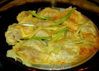 Cooking Chinese dumplings with egg pastry at home