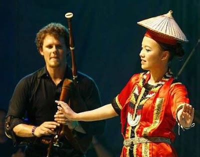French beat: Minuit Guibolles from France playing the bagpipe while a traditional dancer accompanies him.