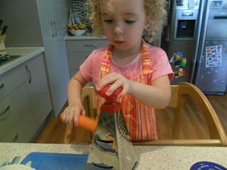 Grating carrot for lunch wrap.