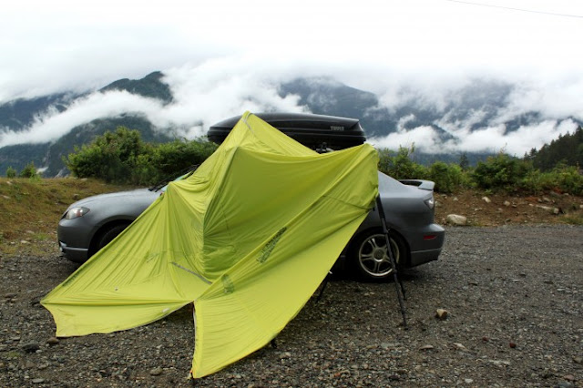 Mazda car parked in Squamish, BC with tent fly attached.