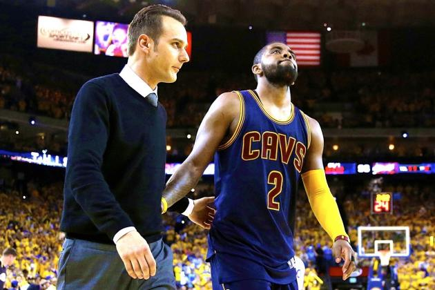 Cavs staff assists injured Kyrie Irving to the Dugout