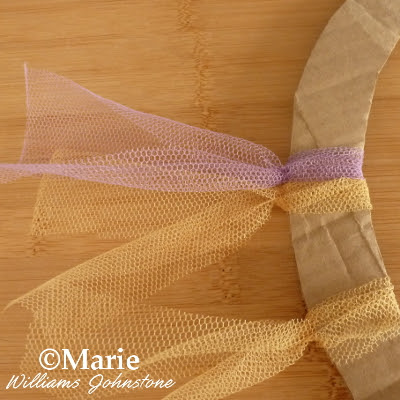 Purple and gold netting strips tied to wreath
