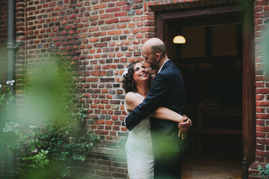 Bride and Groom embrace and smile at each other in Listed Period National trust house.