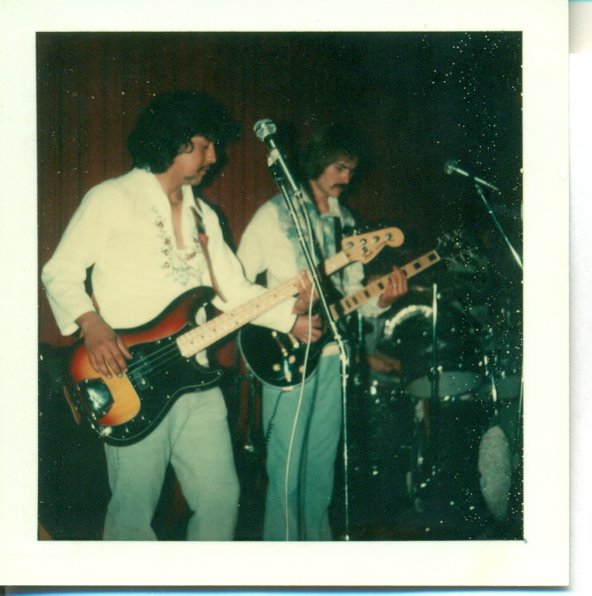 This is a double-shot of Vernon McMahon (right) on rhythm guitar and vocals ...