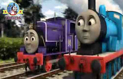 Edward the blue engine and Charlie the train steamed close behind him on the railway sleeper tracks